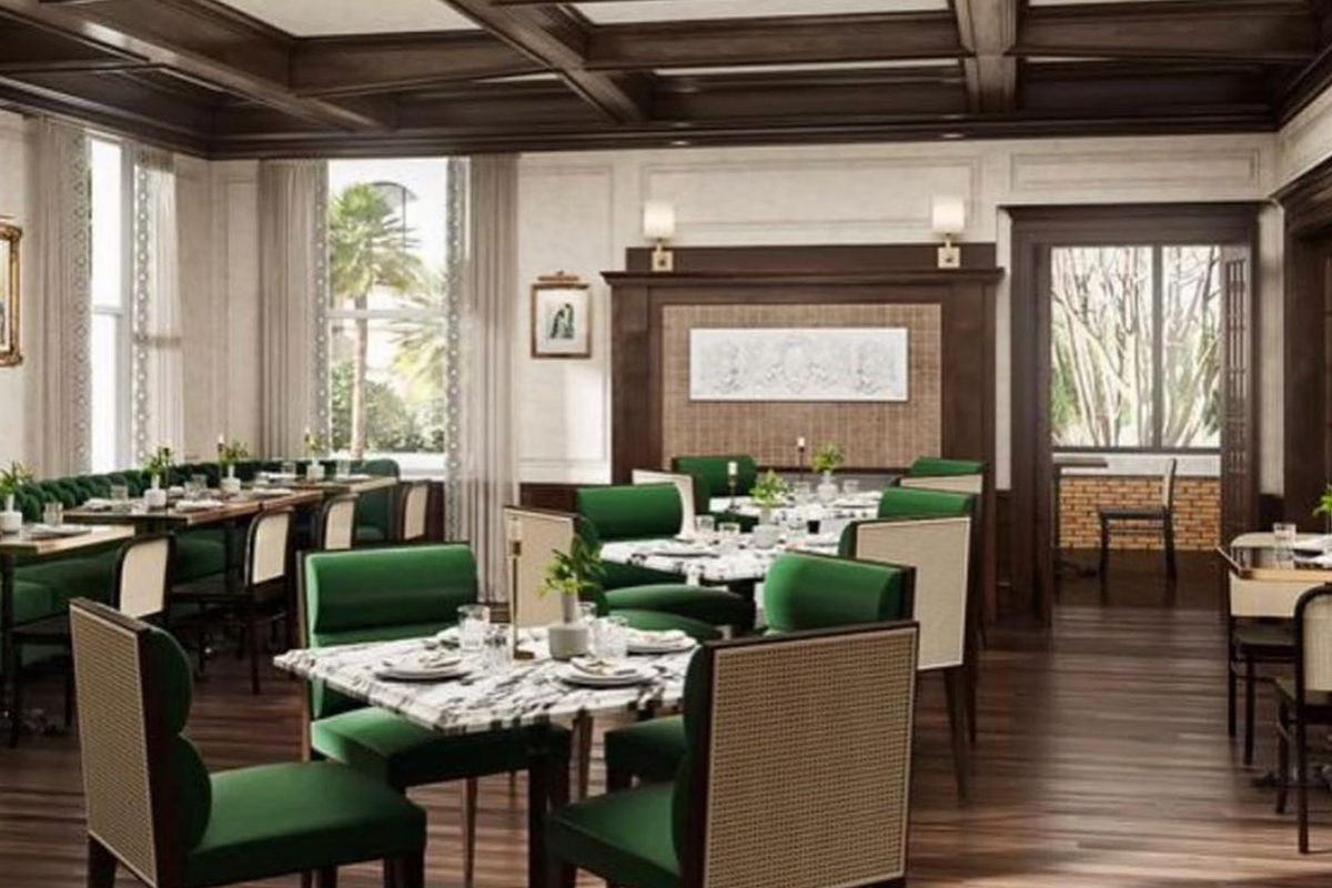 A luxurious dining room with green velvet chairs, marble tables and wood flooring