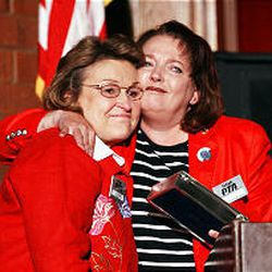 Utah PTA President JoAnn Nielson, left, and Margaret Wahlstrom hug after Wahlstrom was recognized at Taylorsville High School. Wahlstrom's mother-in-law and sister-in-law were killed at the World Trade Center.