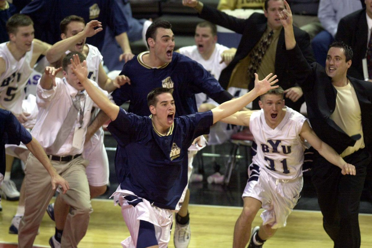 BYU celebrates win over New Mexico. MWC tournament in Las Vegas, March 10, 2001.