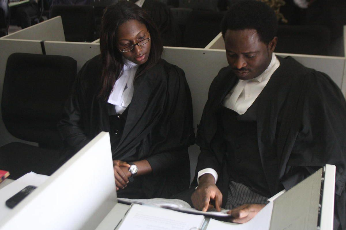 Lawyers Tope Adebayo, right, and Flora Ogbuitepu, left, prepare for a court hearing representing an organization called the Save Nigeria Group over the deployment of soldiers during January fuel protests in Lagos, Nigeria on Tuesday, April 3, 2012. A laws
