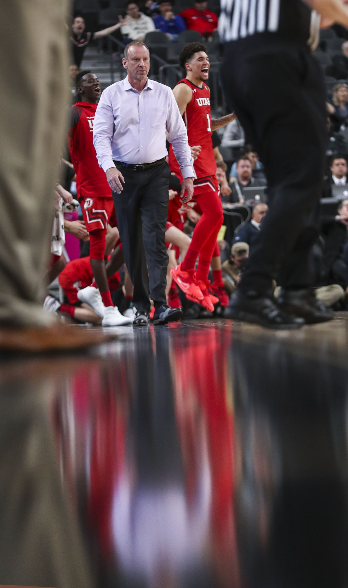 Utah Utes head coach Larry Krystkowiak and the bench celebrate a Utah 3-pointer against Oregon State during the first round of the Pac-12 men's basketball tournament at T-Mobile Arena in Las Vegas on Wednesday, March 11, 2020.