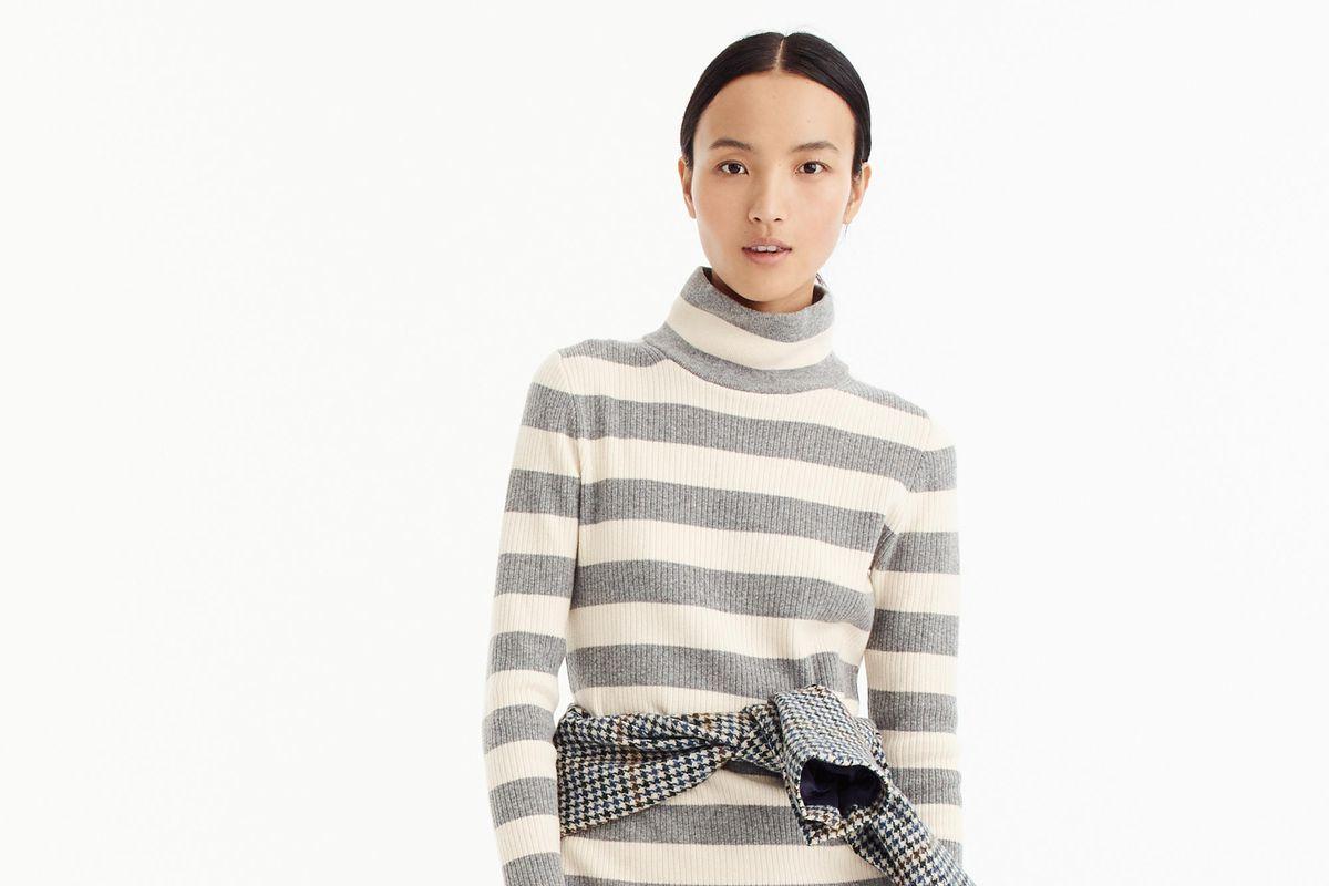 A model in a J.Crew sweater dress