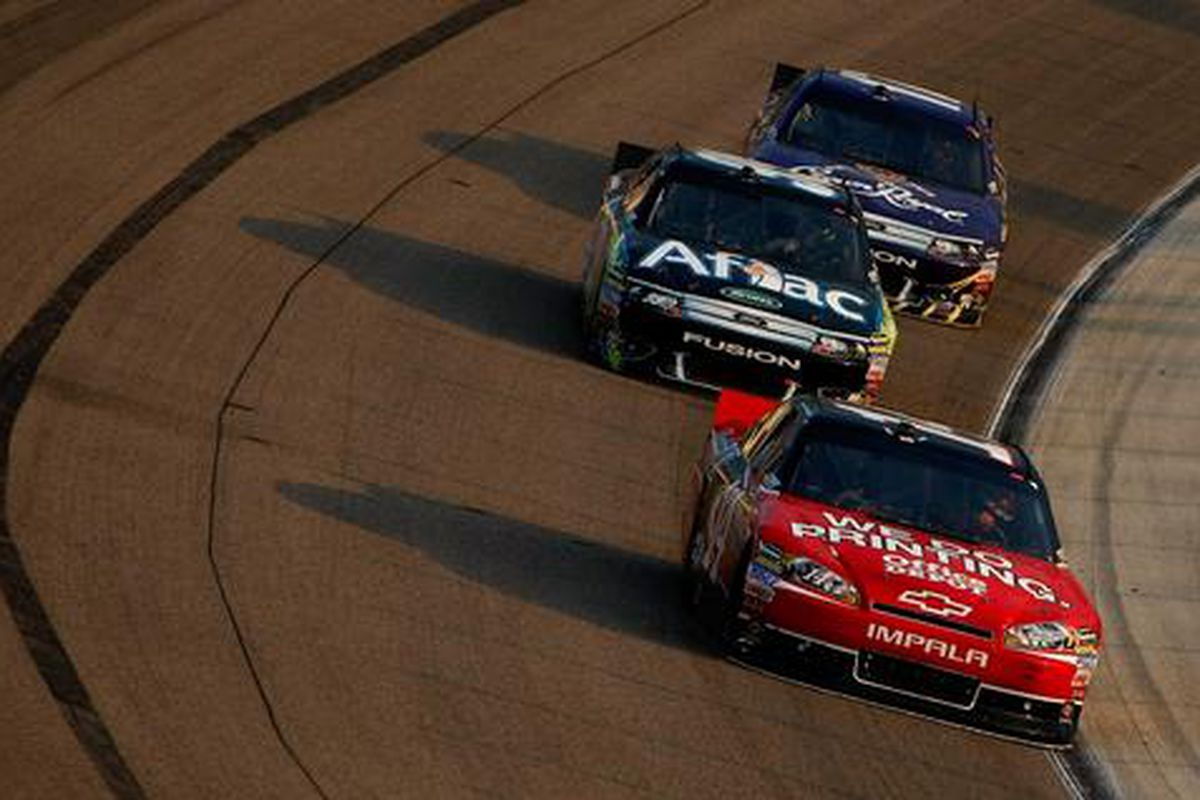 Tony Stewart and Carl Edwards run one and two at Texas Motor Speedway.