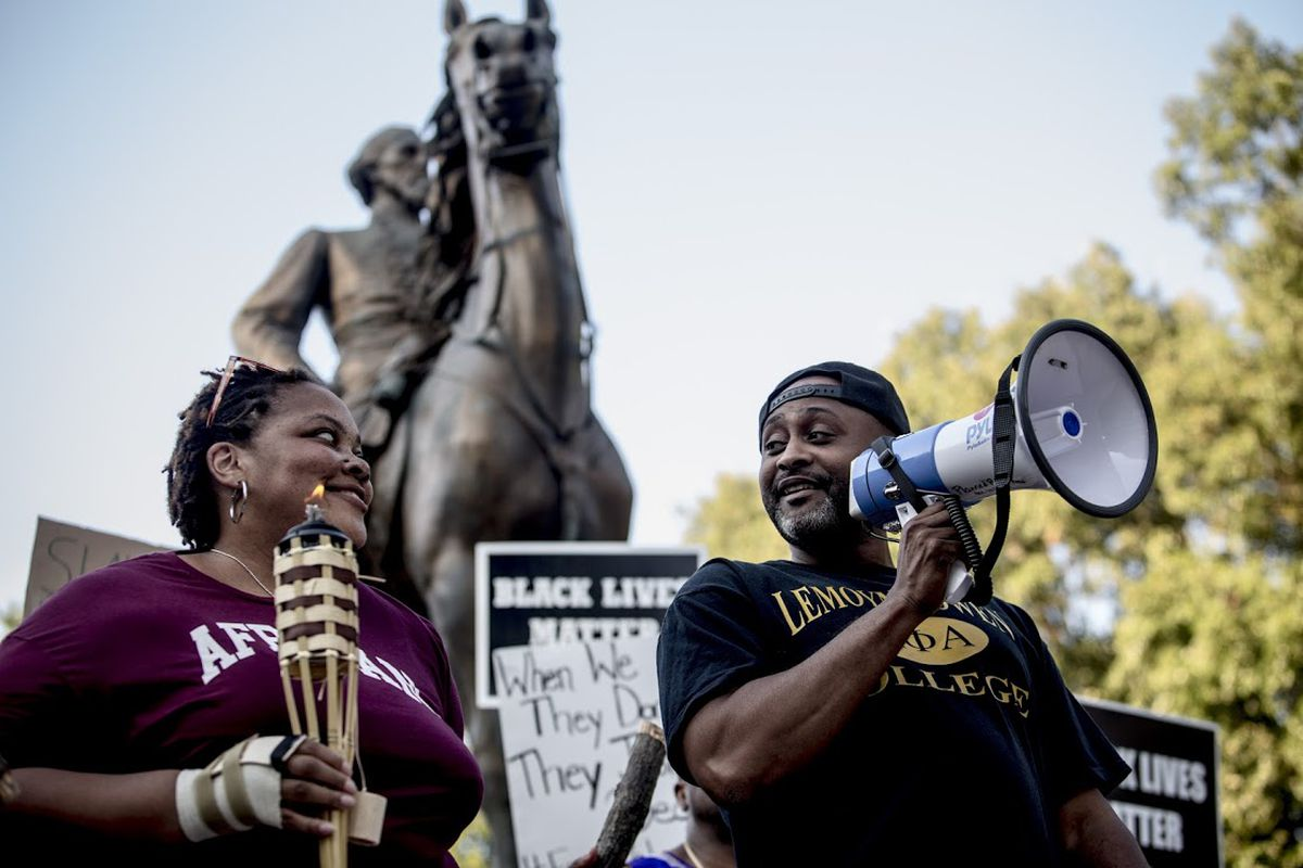 Tami Sawyer and Earle Fisher lead a rally in response to a white supremacist march in Charlottesville last weekend.