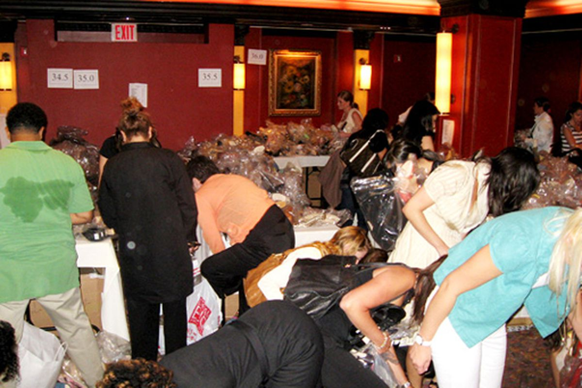 """Will any of today's sales end in sample sale mayhem? We can't help but wonder why the back of that guy's shirt is all wet. Image via <a href=""""http://www.papermag.com/blogs/manolo_large.jpg&amp;imgrefurl=http://www.papermag.com/blogs/2007/05/live_fro"""