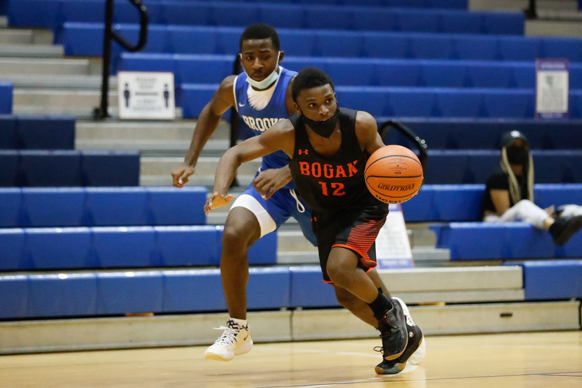 Bogan's Jarvis McNeal takes the ball down the court against Brooks.