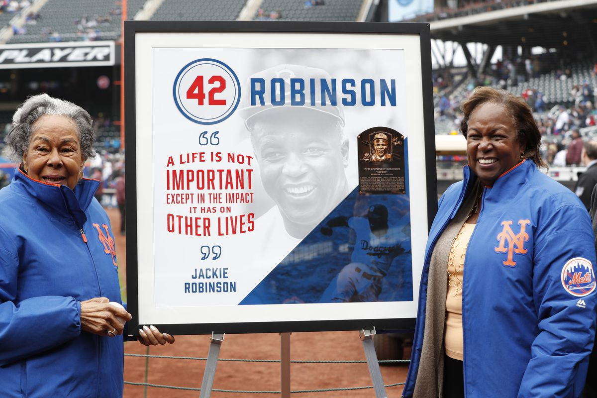 Rachel Robinson, left, widow of Jackie Robinson, and daughter Sharon pose for a photograph with a plaque honoring Jackie on Jackie Robinson Day in 2018.