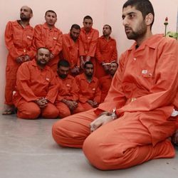 Handcuffed suspects seen in the federal police headquarters in Baghdad, Iraq, Sunday, April 8, 2012. Iraqi officials say they have arrested a ring of insurgents allegedly involved in attacks in Baghdad.