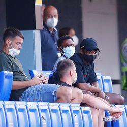 Marc-Andre ter Stegen and Ansu Fati watch from the stands
