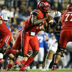 Utah Utes quarterback Tyler Huntley (1) looks to pass during the game against the Brigham Young Cougars at LaVell Edwards Stadium in Provo on Saturday, Sept. 9, 2017.