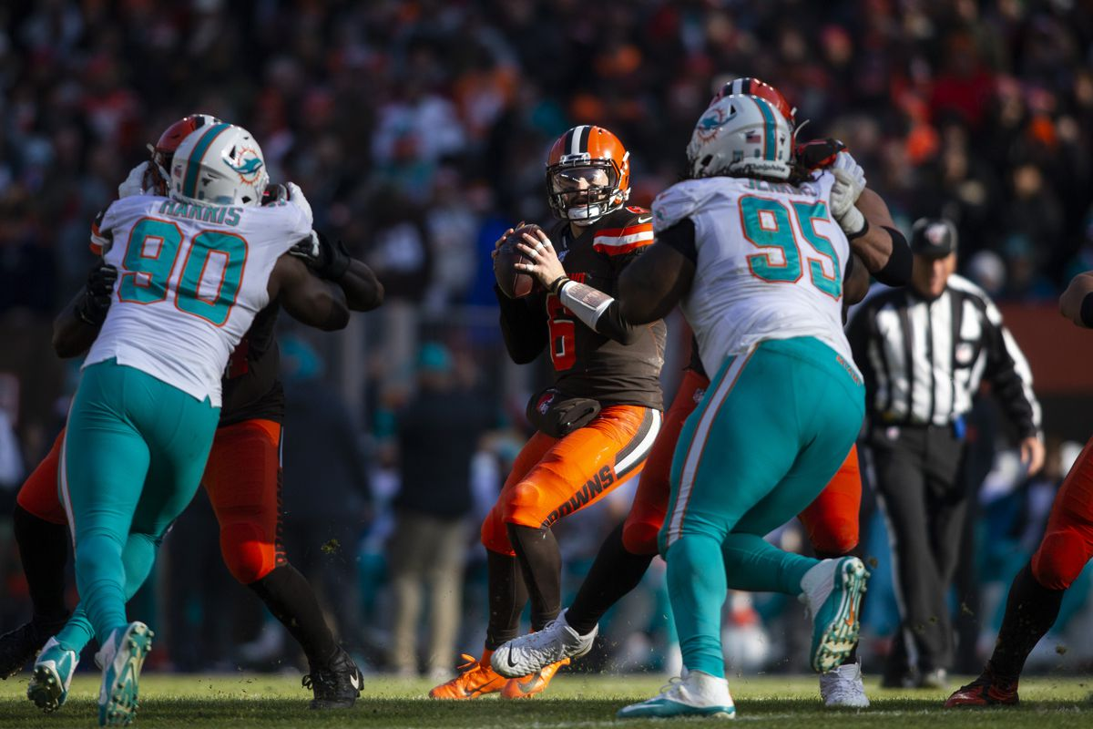 Cleveland Browns quarterback Baker Mayfield looks for an open receiver against the Miami Dolphins during the second quarter at FirstEnergy Stadium.