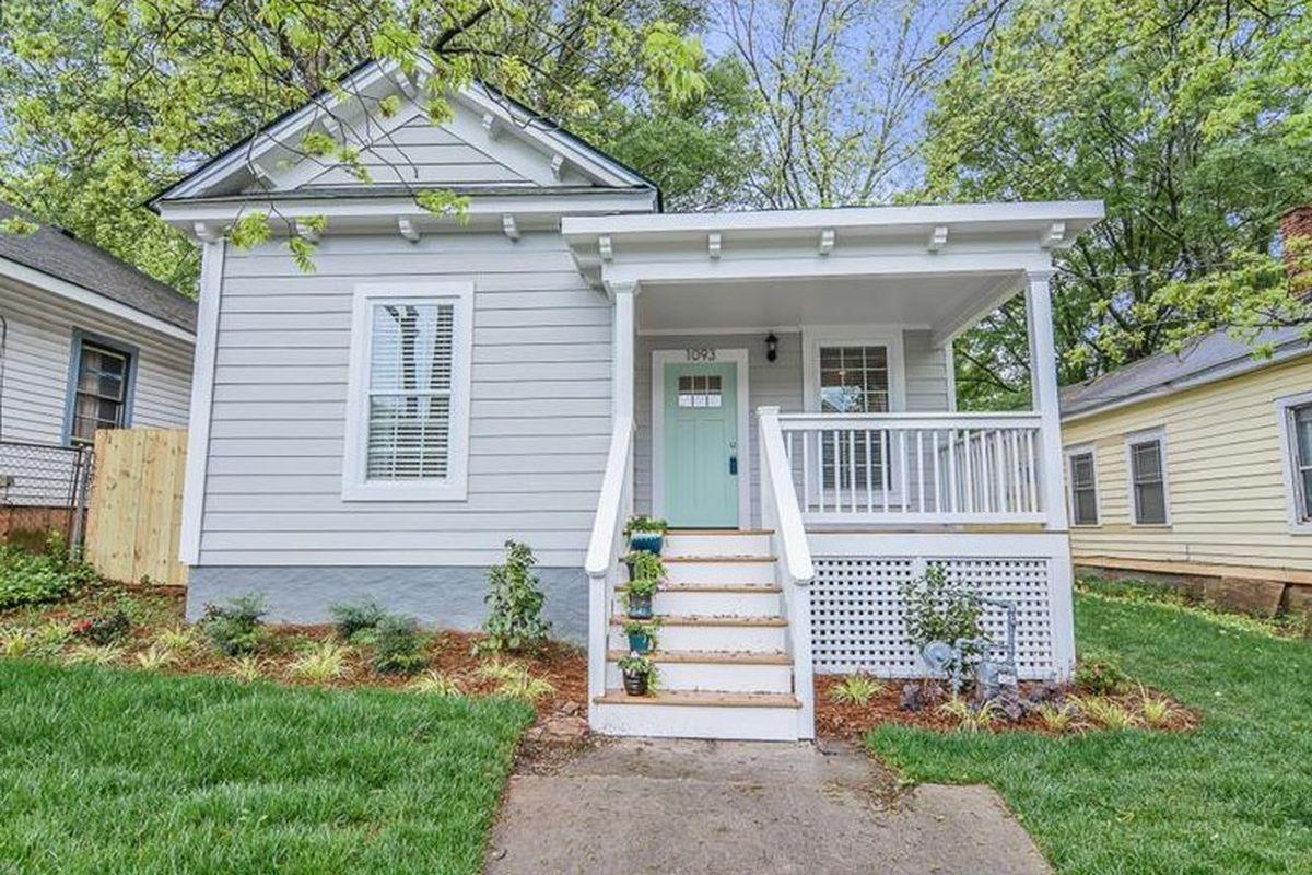 A blue-doored cottage on Kirkwood Avenue in Reynoldstown, Atlanta.