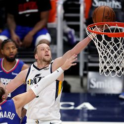 Utah Jazz forward Joe Ingles (2) glides in over LA Clippers guard Luke Kennard (5) for a shot as the Utah Jazz and LA Clippers play in an NBA basketball game at Vivint Smart Home Arena in Salt Lake City on Friday, Jan. 1, 2021. Utah won 106-100.