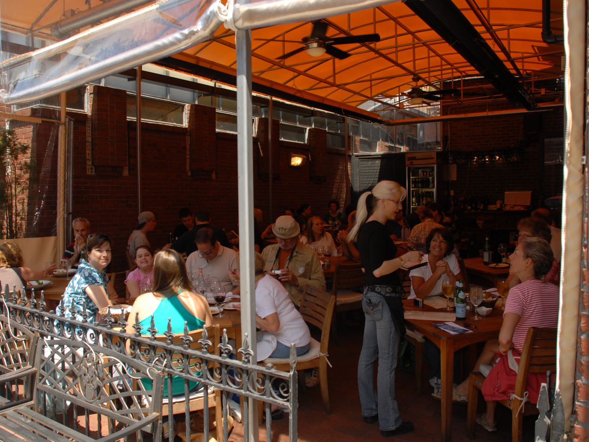 Diners eat on a tent-covered patio in Boston's North End.