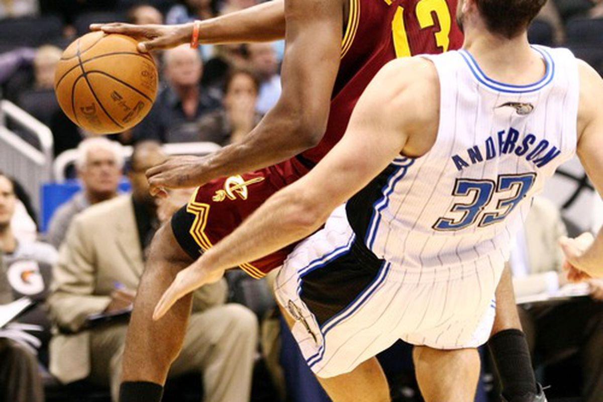Mar 23, 2012; Orlando, FL, USA; Cleveland Cavaliers forward Tristan Thompson (13) charges Orlando Magic power forward Ryan Anderson (33) during the second quarter at Amway Center. Mandatory Credit: Douglas Jones-US PRESSWIRE