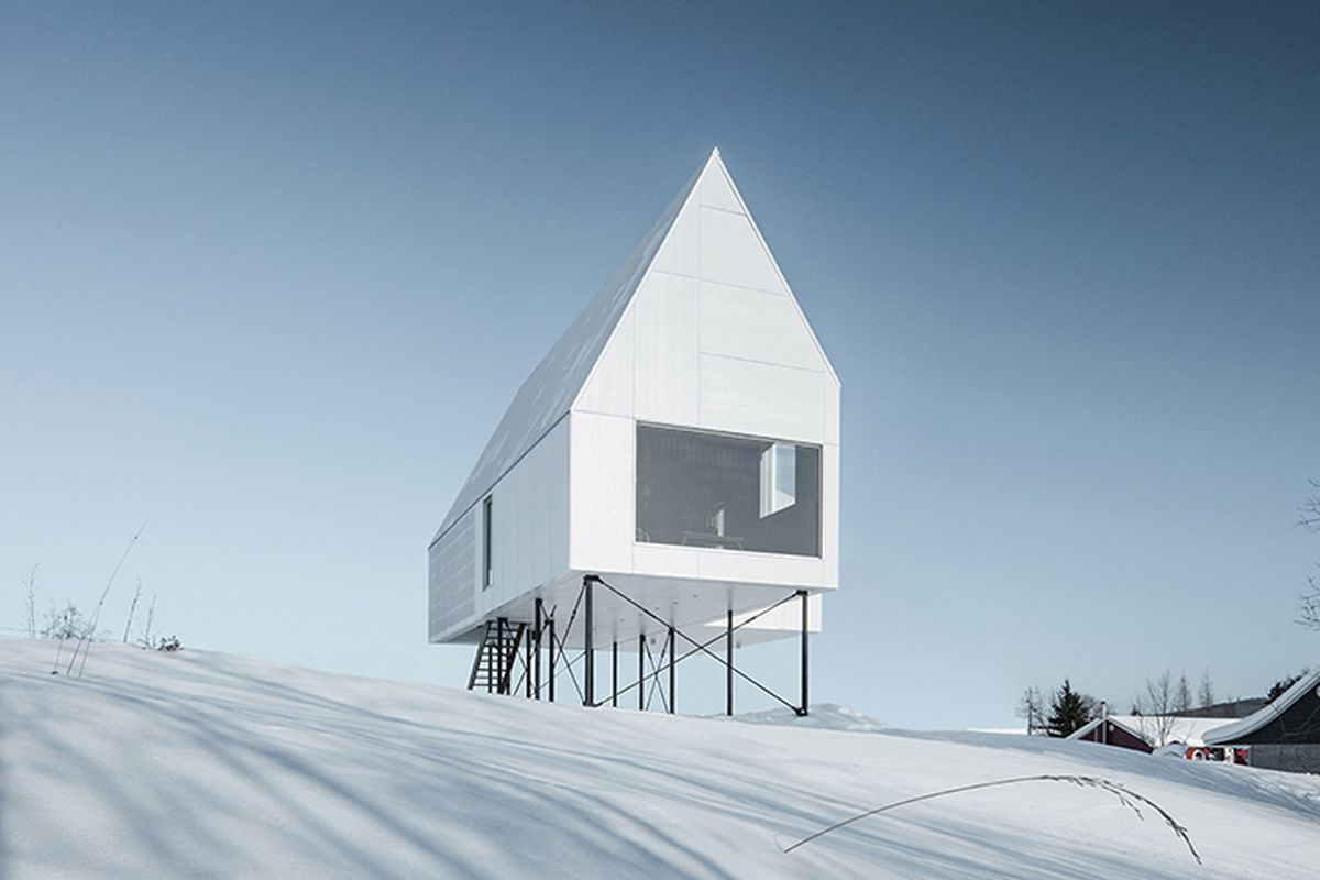 Modern Chalet On Stilts Rises Above Winter Snow Curbed