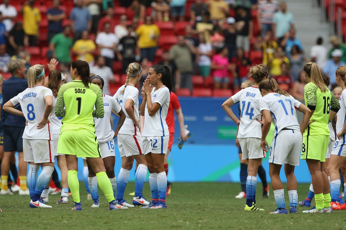 The United States players look dejected after losing in the penalty shoot out during the Women's Quarter Final match between United States and Sweden on Day 7 of the Rio 2016 Olympic Games at Mane Garrincha Stadium on August 12, 2016 in Brasilia, Brazil.
