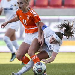 Ridgeline forward London Miller (10) gets tangled up with Ogden's Alysia Butters (11) during the second half of the 4A girls state championship at Rio Tinto Stadium in Sandy on Friday, Oct. 25, 2019. Ogden defeated Ridgeline 2-1 in regulation time.