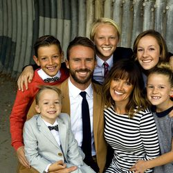 Katie Parker, pictured here with her husband, Matthew, and their five children, prioritizes faith and family in order to balance her responsibilities.