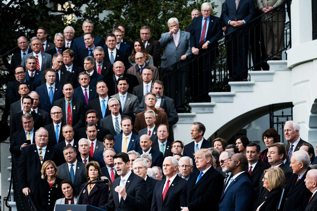 Republican leaders gather on the steps of the White House to celebrate the passage of their tax cut plan.