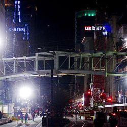 A skybridge is hoisted above Main Street and lowered in to place connecting the City Creek Center development in downtown Salt Lake City Sunday.