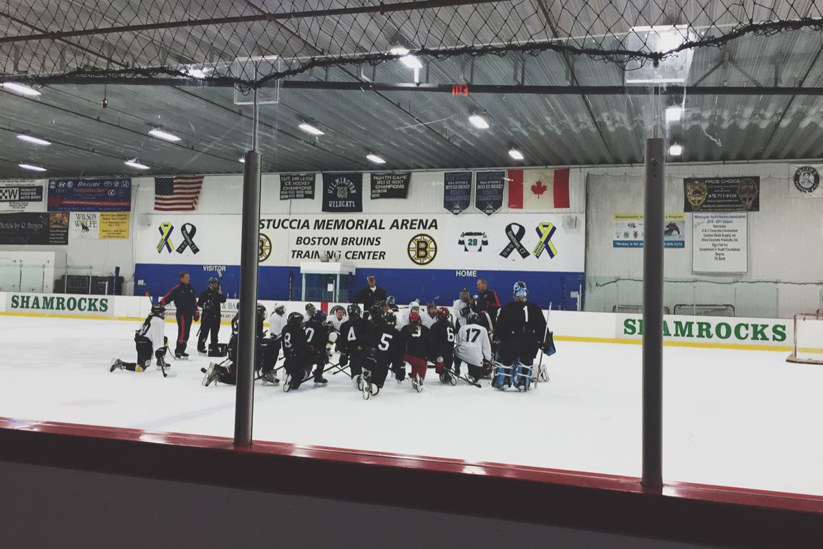 Team meeting: Boston Pride camp attendants cluster around coaches this weekend at center ice at Ristuccia