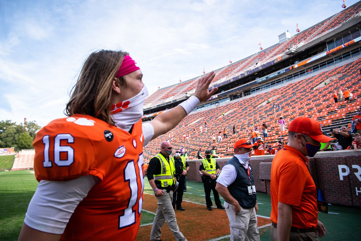 Clemson quarterback Trevor Lawrence (16) waves to fans after their game against Syracuse at Memorial Stadium.