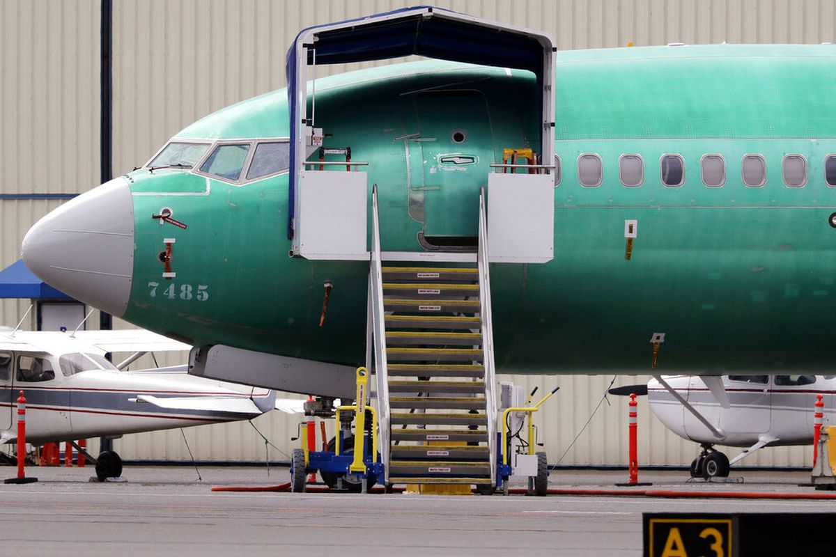 Boeing 737 MAX 7 jet is parked near single engine planes at the airport adjacent to a Boeing Co. production facility in Renton, Wash.