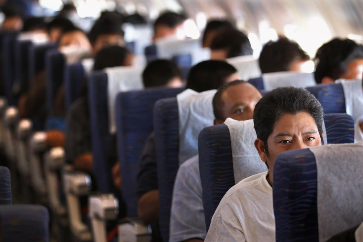 FILE - Returning Guatemalan immigrants fly on a deportation flight from Mesa, Arizona on June 24, 2011 in flight to Guatemala City, Guatemala. Immigration detainees formerly held in Utah have been transferred to detention facilities as far away as Alabama
