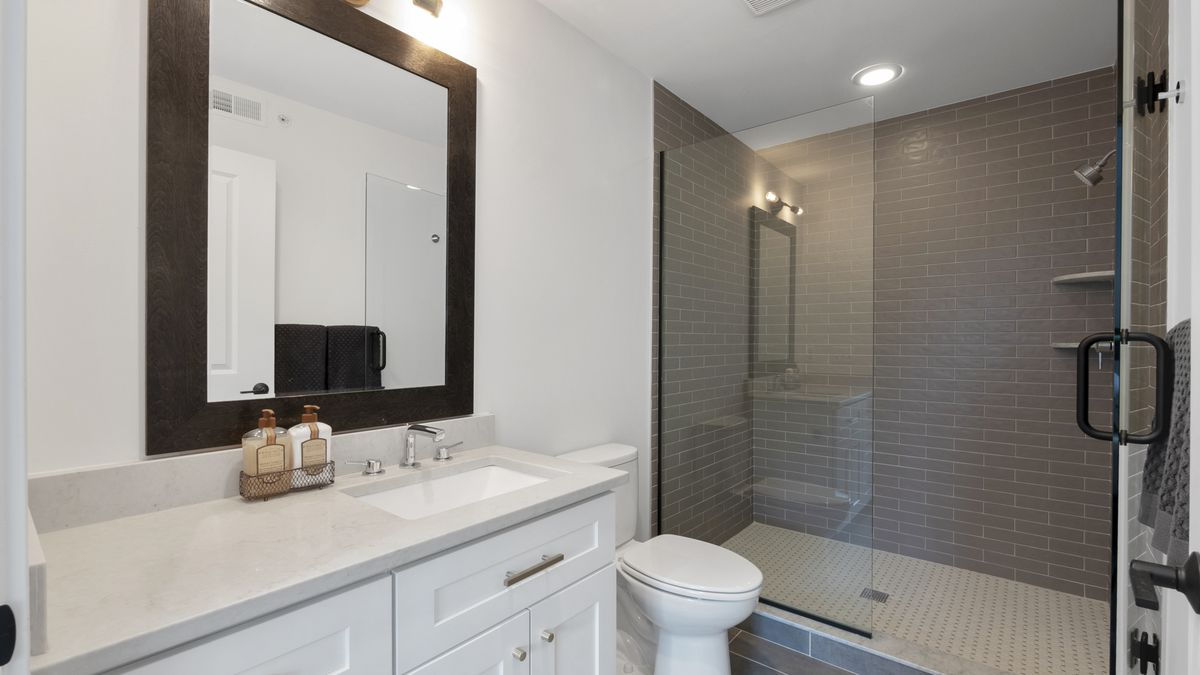 The master bathroom with tiled shower