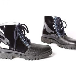 """New Kid 'Remy' boot, <a href=""""http://shoemarketnyc.com/shop/shoes/shop-by-style/womens-boots/new-kid-remy-loot-black"""">$188.80</a> at Shoe Market"""