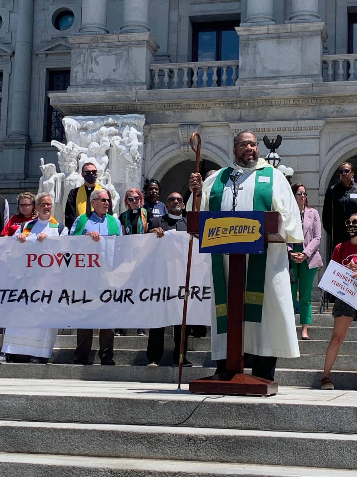 Rev. Dwayne Royster leads a rally on fair education funding at the state capitol building last month.