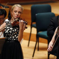 Maggie Ivory, left, and Rebecca Epperson perform on the violin and viola during the 55th annual Salute to Youth concert in Salt Lake City Tuesday, Sept. 30, 2014.