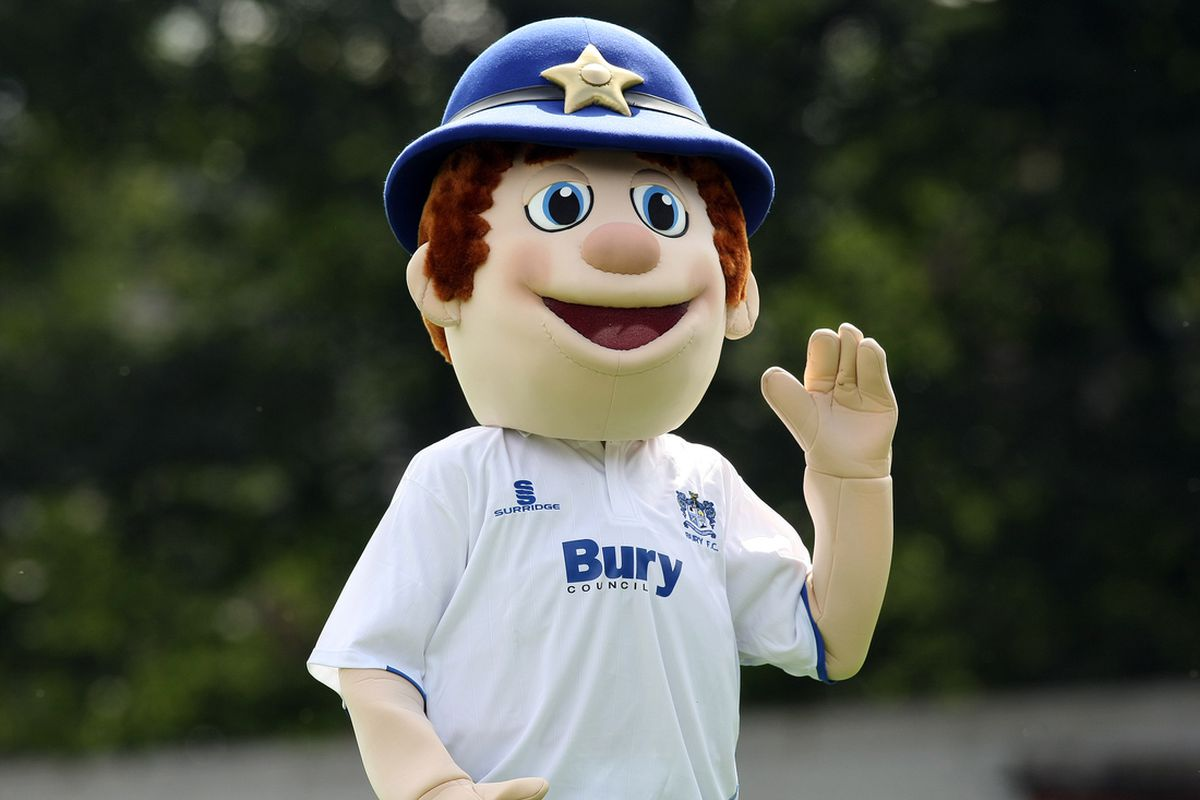 Robbie The Bobbie waves goodbye to Wade Joyce. Possibly. Maybe he's directing traffic.