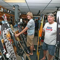 Jackson Knoll and he father, Paul Knoll, own Jackson's Base Camp ski and sporting goods shop at the base of Park City Mountain Resort, Wednesday, July 2, 2014, in Park City.