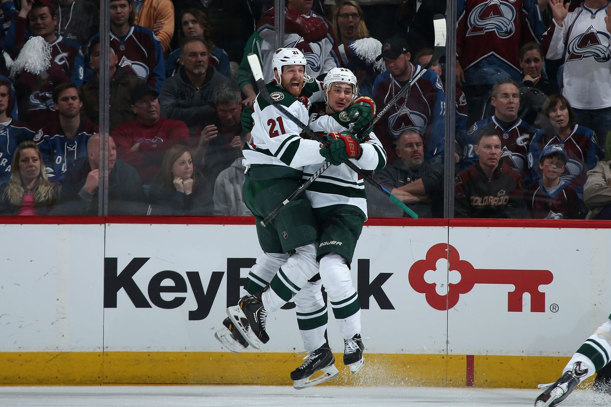 Kyle Brodziak appears excited about Nino Niederreiter's birthday. Or maybe it's the goal. Yeah, it might be that.