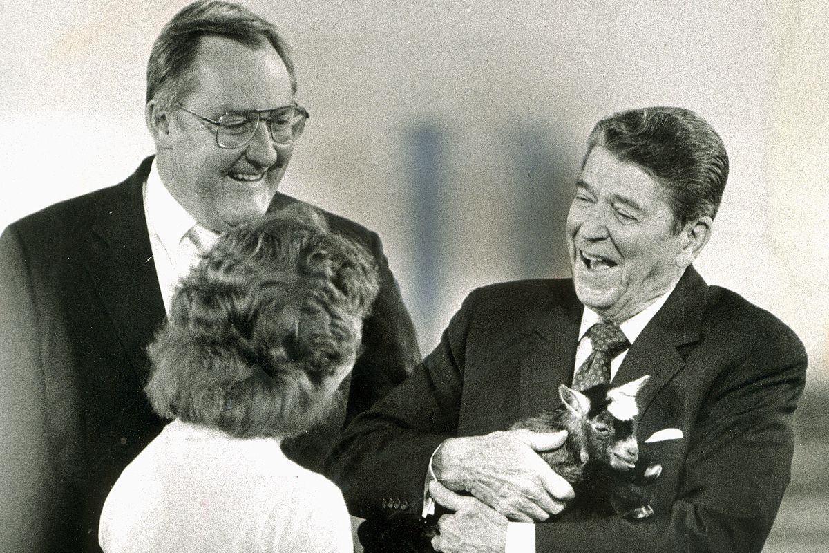 President Ronald Reagan attends the Illinois State Fair in Springfield in 1986 with Gov. James Thompson. Reagan is holding a 4-day-old goat belonging to Carry Marshall, 16, of Decatur.