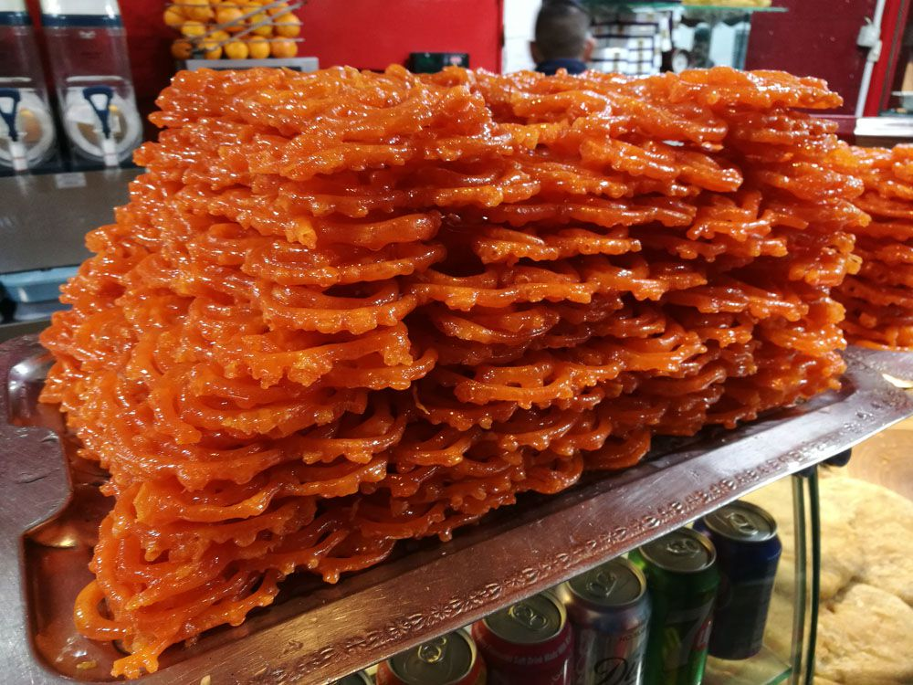jalebi waiting for their syrup at jalebi junction, southall, one of London's best bakeries