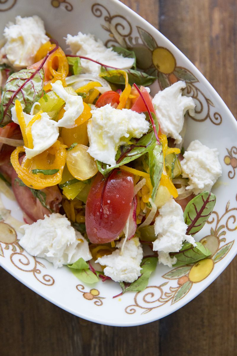 A bright summer salad with ricotta cheese and tomatoes.