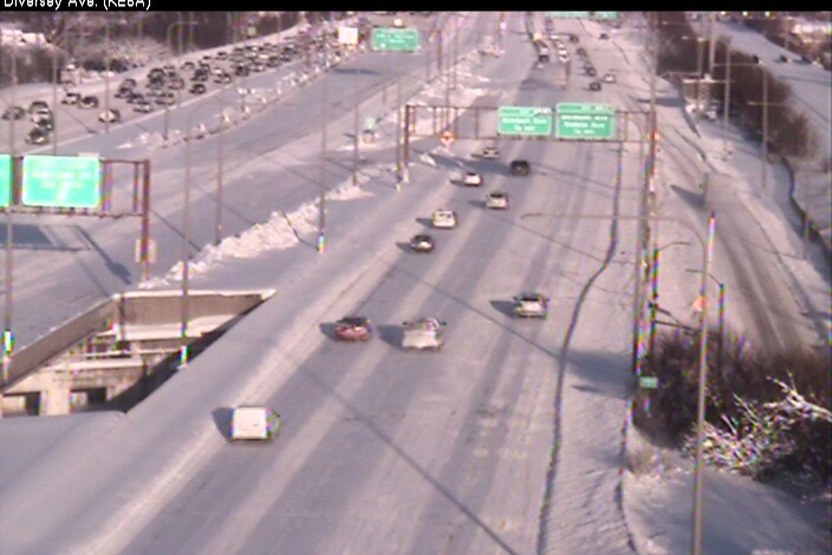 A snowy Kennedy Expressway prevented the express lanes gates from opening Tuesday morning.