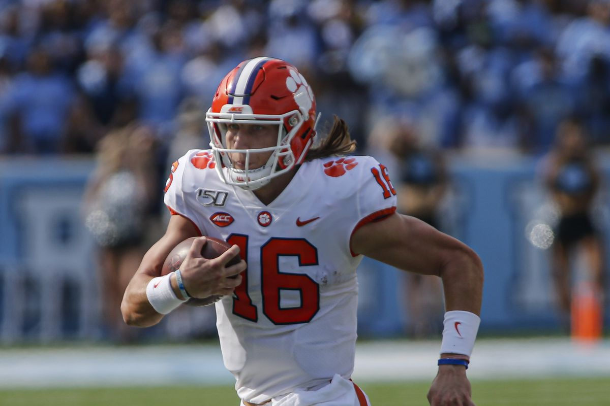 Clemson Tigers quarterback Trevor Lawrence (16) carries the football against the North Carolina Tar Heels in the first half at Kenan Memorial Stadium.