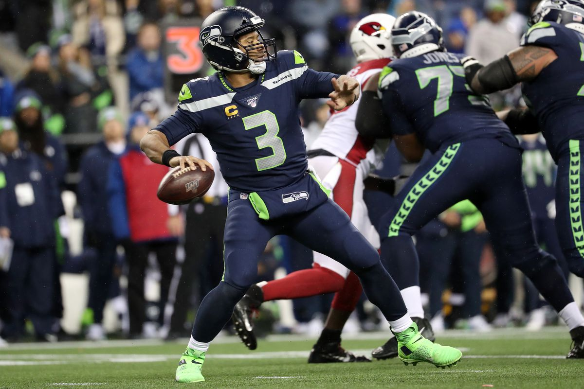 Russell Wilson of the Seattle Seahawks throws the ball in the fourth quarter against the Arizona Cardinals during their game at CenturyLink Field on December 22, 2019 in Seattle, Washington.