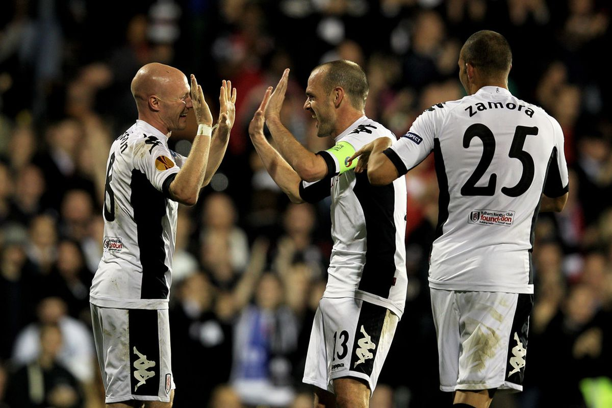 Andy Johnson, Danny Murphy and Bobby Zamora celebrating after a goal against Wisla Krakow, who Fulham defeated 4-1 in the Europa League on Thursday