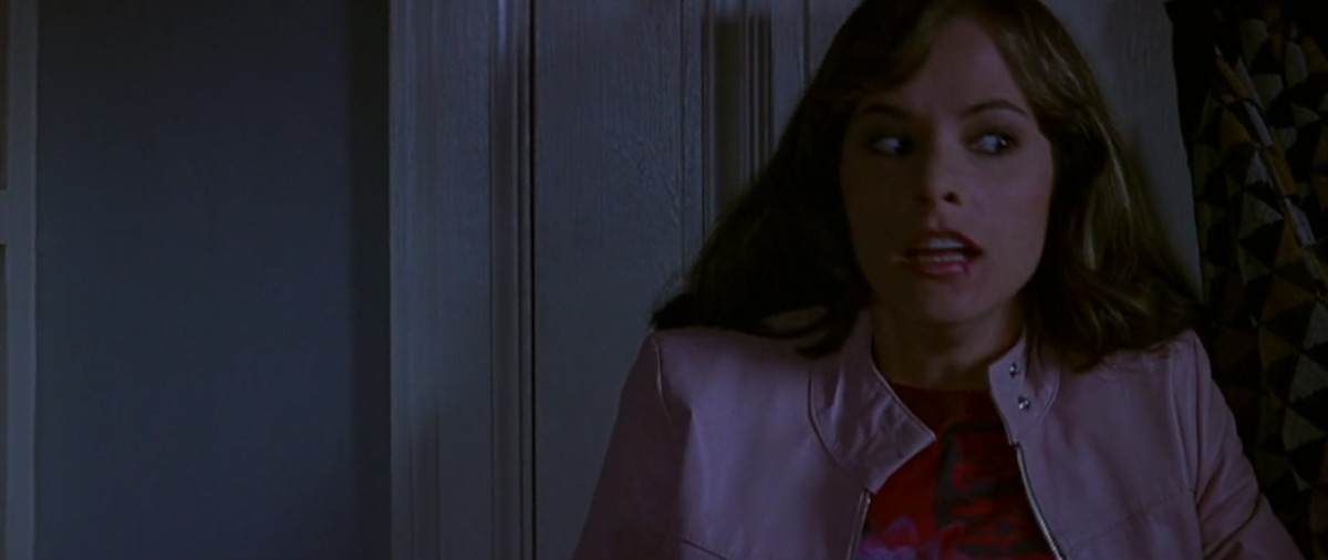 jennifer jolie (parker posey) catches her breath after jumping into a closet