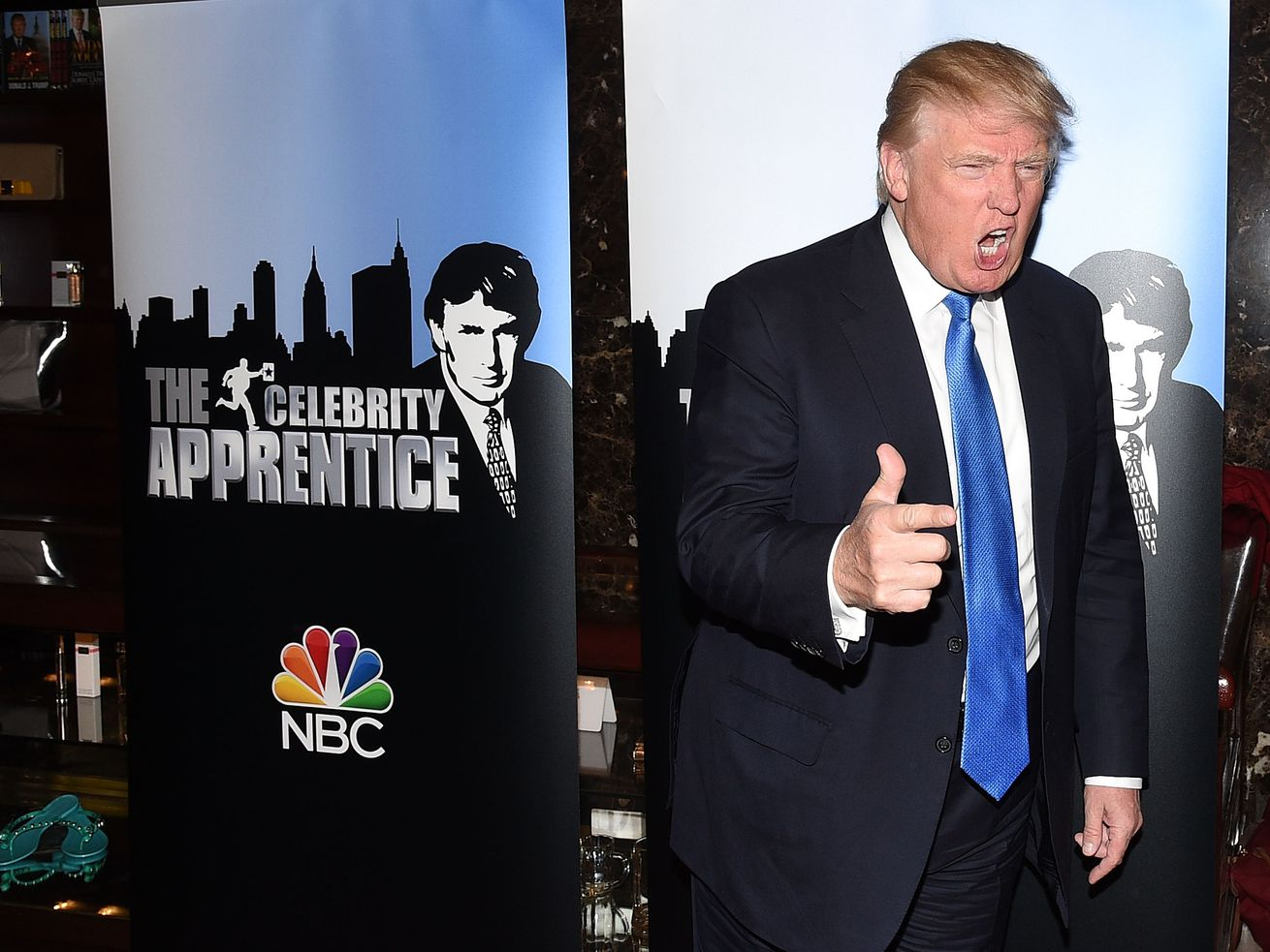 Donald Trump poses on the red carpet for a <em>Celebrity Apprentice </em>event in New York City in February 2015.