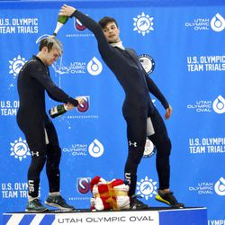 John-Henry Krueger, right, pours champagne over the head of Ryan Pivirotto, left, on the podium following the U.S. Olympic short track speedskating trials Sunday, Dec. 17, 2017, in Kearns, Utah. (AP Photo/Rick Bowmer)