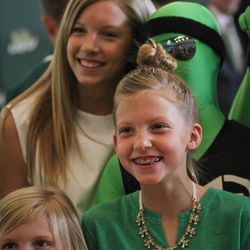Three of Mark Pope's daughters -- (top to bottom) Ella, Layla and Shay --mug for the cameras at a press conference announcing their father as the new UVU coach.