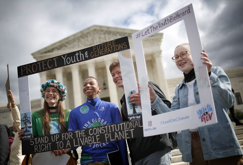Protesters rally in front of the US Supreme Court in 2018 in favor of the plaintiffs in the kids climate lawsuit, Juliana v. US.