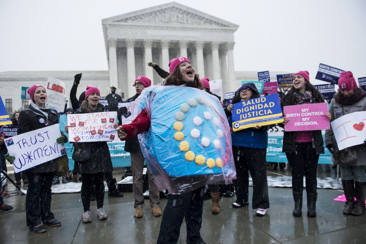 Pro-reproductive rights activists stand outside the Supreme Court.