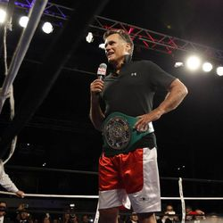 Former Massachusetts Gov. Mitt Romney addresses the crowd after his fight during the Charity Vision Fight Night event in Salt Lake City, Friday, May 15, 2015.